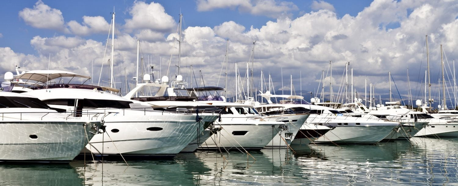 Row of luxury yachts mooring in a harbour