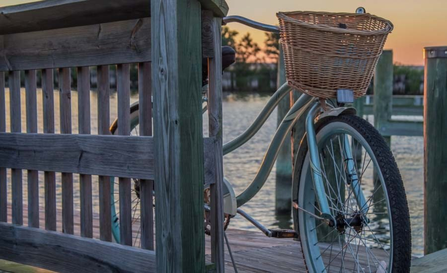 Bike with basket on a beach bridge
