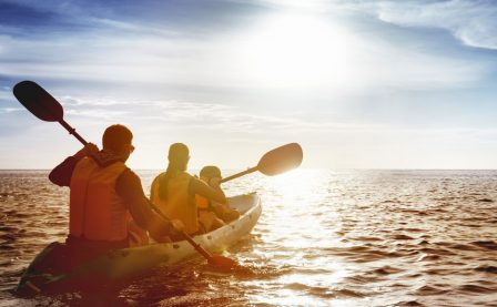 Family kayaking on the ocean