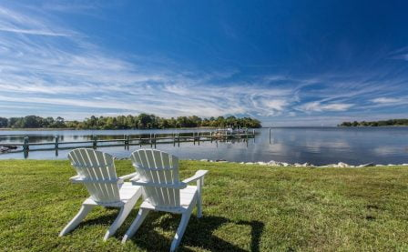 Eastern Shore MD - Adirondack chairs on a lawn by the water
